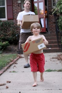 boy-moving-box-helping