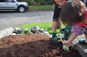kids-moving-plant-garden